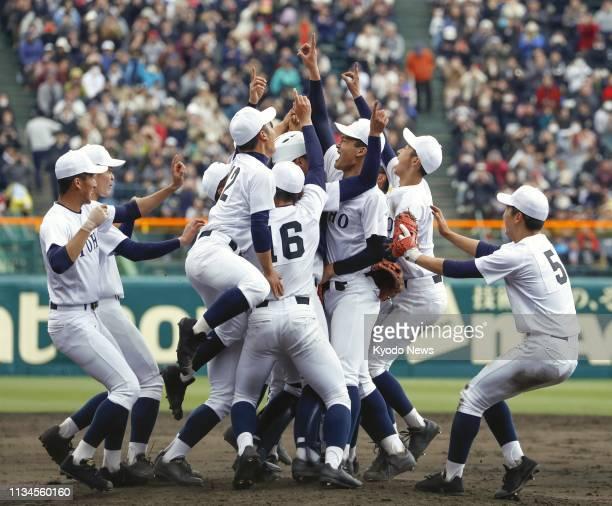 Toho players celebrate after beating Narashino to win the national high school baseball invitational championship at Koshien Stadium in Nishinomiya...