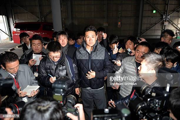 Tohoku Rakuten Golden Eagles pitcher Masahiro Tanaka speaks to media reporters after his meeting with the president Yozo Tachibana at the team's...