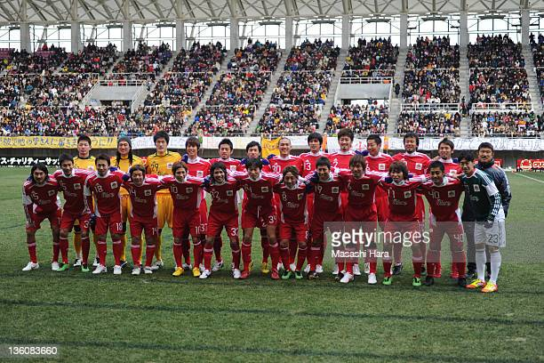 Tohoku Region XI Players pose for photograph prior to the JPFA Xmas Charity Soccer between Tohoku Region XI and JPFA XI at Yurtec Stadium Sendai on...