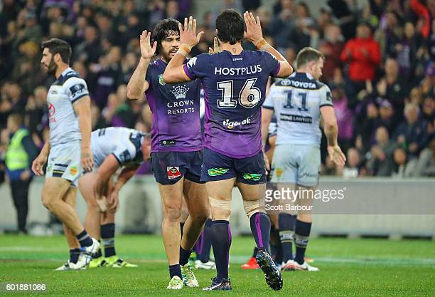 Tohu Harris and Jordan McLean of the Storm celebrate after winning the NRL Qualifying Final match between the Melbourne Storm and the North...