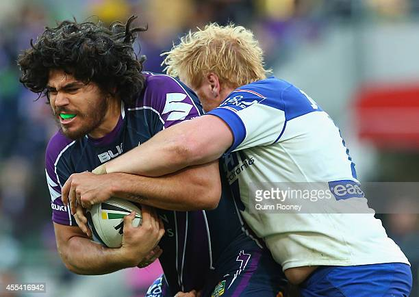 Tohu Harris of the Storm is tackled by James Graham of the Bulldogs during the NRL 2nd Elimination Final match between the Melbourne Storm and the...