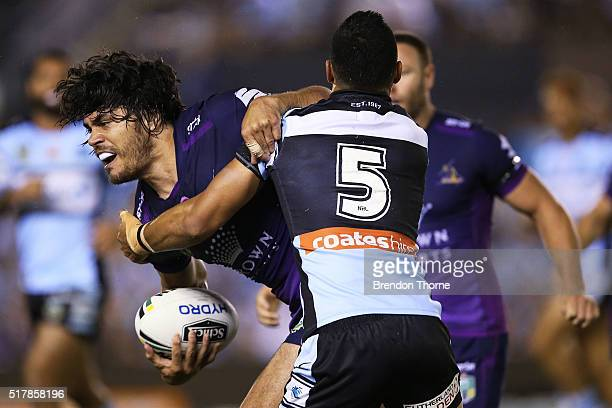 Tohu Harris of the Storm is tackled by Valentine Holmes of the Sharks during the round four NRL match between the Cronulla Sharks and the Melbourne...