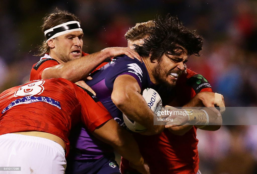 Tohu Harris of the Storm is tackled during the round 15 NRL match between the St George Illawarra Dragons and the Melbourne Storm at WIN Stadium on June 18, 2016 in Wollongong, Australia.