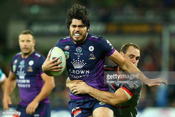 Tohu Harris of the Storm is tackled during the round eight NRL match between the Melbourne Storm and the New Zealand Warriors at AAMI Park on April...