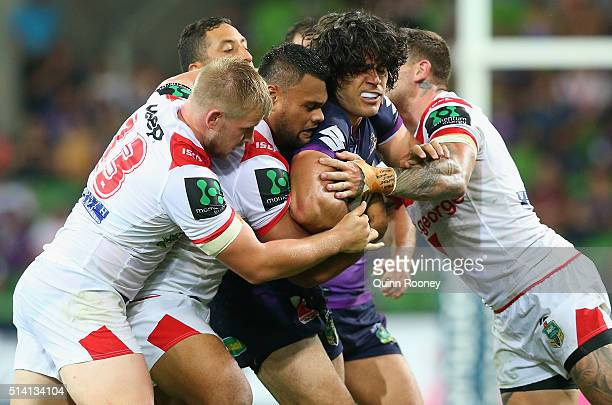 Tohu Harris of the Storm is tackled during the round one NRL match between the Melbourne Storm and the St George Illawarra Dragons at AAMI Park on...