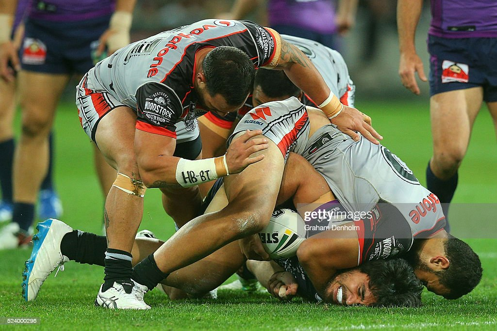 Tohu Harris of the Storm is tackled to the ground during the round eight NRL match between the Melbourne Storm and the New Zealand Warriors at AAMI Park on April 25, 2016 in Melbourne, Australia.