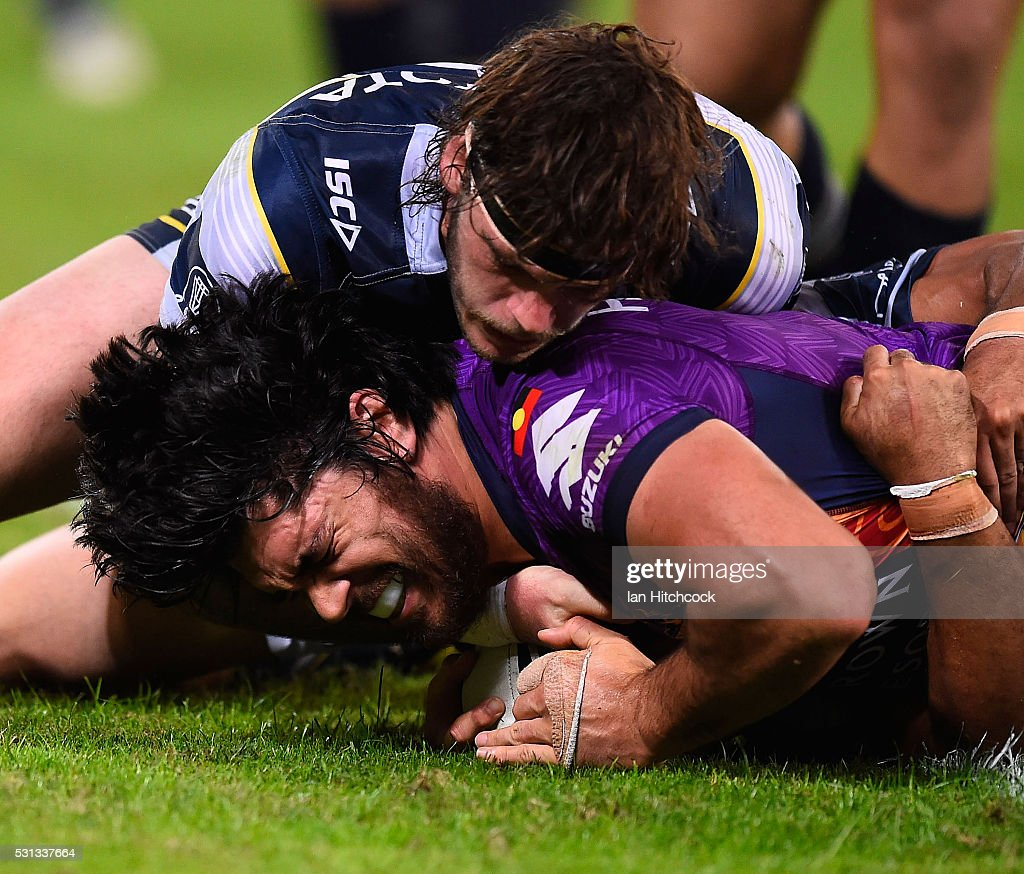 Tohu Harris of the Storm scores a try during the round 10 NRL match between the Melbourne Storm and the North Queensland Cowboys at Suncorp Stadium on May 14, 2016 in Brisbane, Australia.