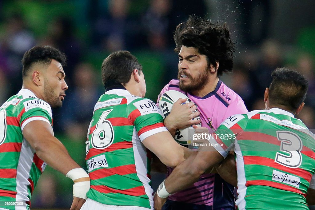 Tohu Harris of the Stormis tackled during the round 22 NRL match between the Melbourne Storm and the South Sydney Rabbitohs at AAMI Park on August 6, 2016 in Melbourne, Australia.