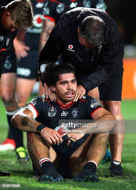 Tohu Harris of the Warriors is looked over by doctor John Mayhew during the round seven NRL match between the New Zealand Warriors and the St George...
