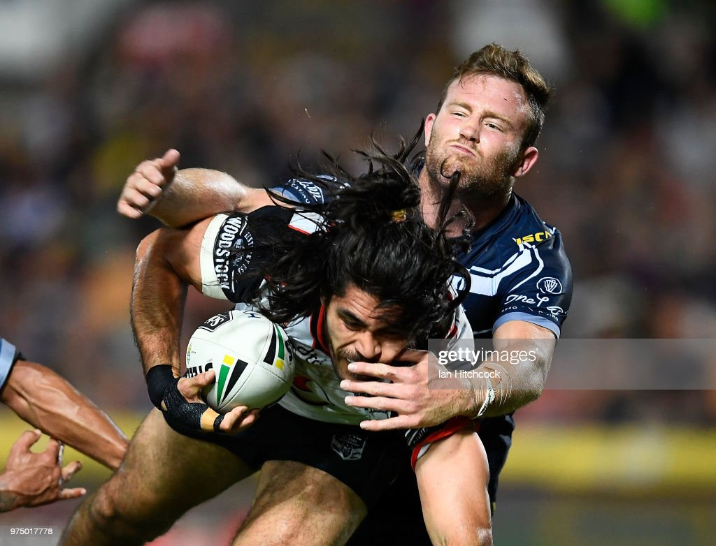 Tohu Harris of the Warriors is tackled by Gavin Cooper of the Cowboys during the round 15 NRL match between the North Queensland Cowboys and the New Zealand Warriors at 1300SMILES Stadium on June 15, 2018 in Townsville, Australia.