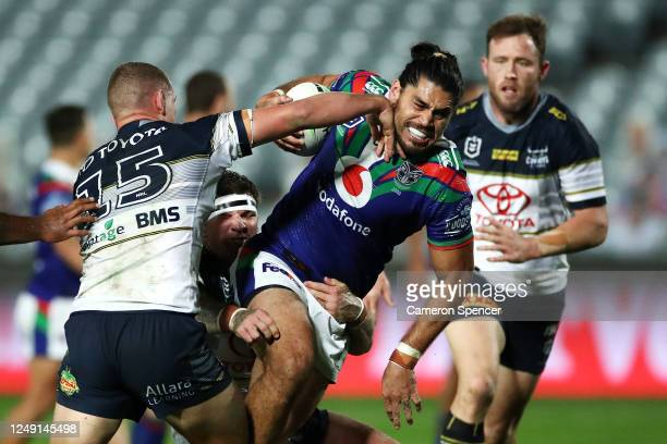 Tohu Harris of the Warriors is tackled during the round five NRL match between the New Zealand Warriors and the North Queensland Cowboys at Central...