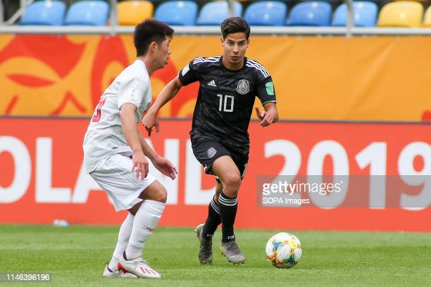 Toichi Suzuki from Japan and Diego Lainez from Mexico are seen in action during the FIFA U20 World Cup match between Mexico and Japan in Gdynia