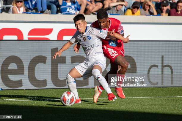 Toichi Suzuki of FC Lausanne-Sport battles for the ball with David Wesley of FC Sion during the Super League match between FC Lausanne-Sport and FC...