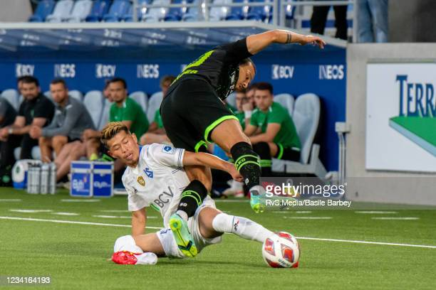 Toichi Suzuki of FC Lausanne-Sport battles for the ball with Nicolas Luchinger of FC St. Gallen 1879 during the Swiss Super League match between FC...