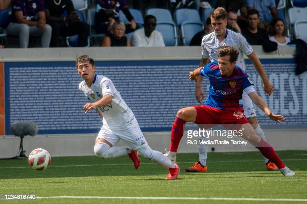 Toichi Suzuki of FC Lausanne-Sport battles for the ball with Valentin Stocker of FC Basel 1893 during the Swiss Super League match between FC...