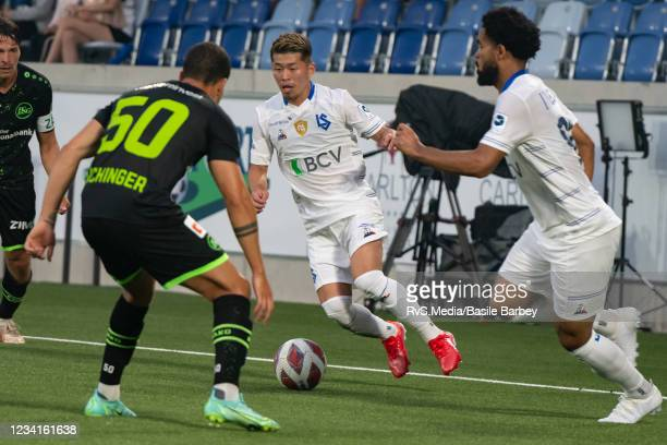 Toichi Suzuki of FC Lausanne-Sport controls the ball in front of Nicolas Luchinger of FC St. Gallen 1879 during the Swiss Super League match between...