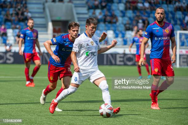 Toichi Suzuki of FC Lausanne-Sport vies with Valentin Stocker of FC Basel 1893 during the Swiss Super League match between FC Lausanne-Sport and FC...