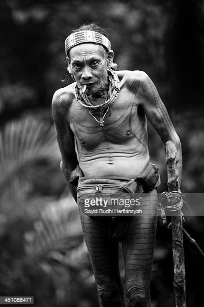 Toikapi, with typical Mentawai tattoos on his body is a tribal leader in Dorogot Village, Siberut Island. This type of tattoo as a powerful identity...