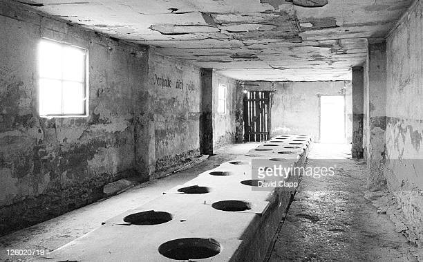 toilet block at birkenau concentration camp, auschwitz, poland - birkenau stock pictures, royalty-free photos & images