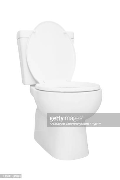 toilet bowl against white background - toilet stock pictures, royalty-free photos & images