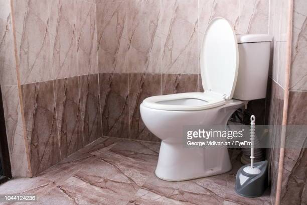 toilet bowl in bathroom - toilet stock pictures, royalty-free photos & images