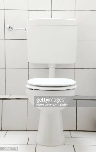 toilet bowl in bathroom - toilet bowl stock photos and pictures