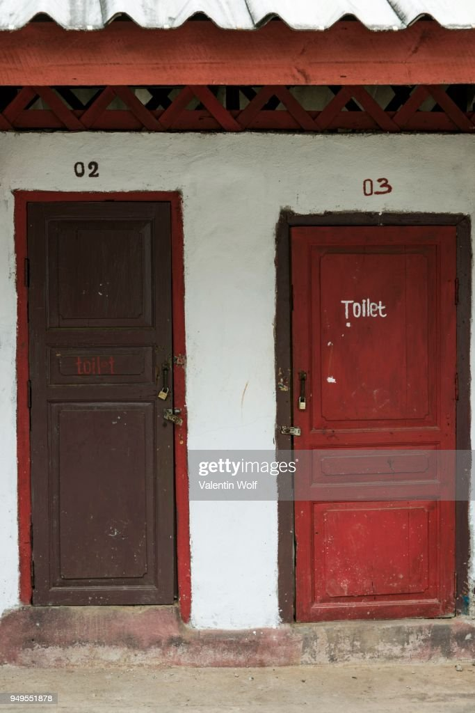 Toilet hut with red doors toilet sign Luang Prabang Province Louangphabang Province & Outhouse Doors Stock Photos and Pictures | Getty Images