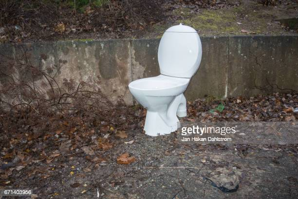 toilet left in the street - toilet bowl stock photos and pictures