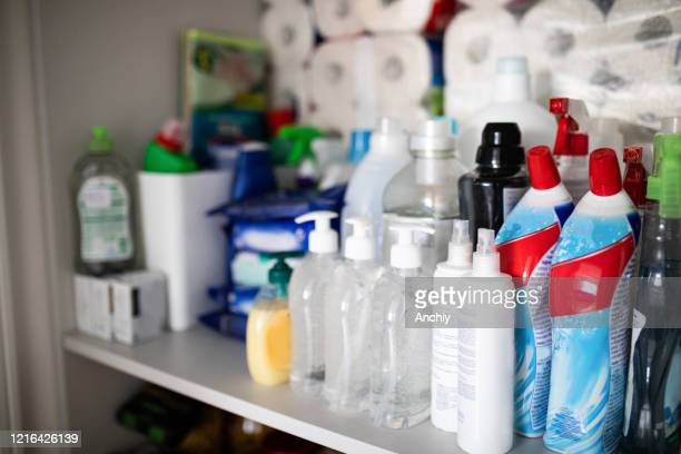 toilet paper and cleaning products hoarding concept - greed stock pictures, royalty-free photos & images