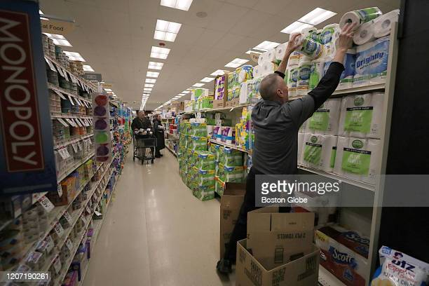 Toilet paper and paper towels are restocked at the Star Market in Brookline, MA on March 13, 2020 after Massachusetts residents stocked up on...