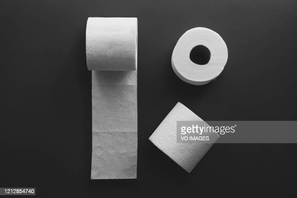 toilet paper rolls on a black background. toilet tissue. - kitchen paper stock pictures, royalty-free photos & images