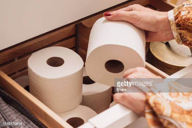 toilet paper storage in bathroom drawer - toilet paper stock pictures, royalty-free photos & images