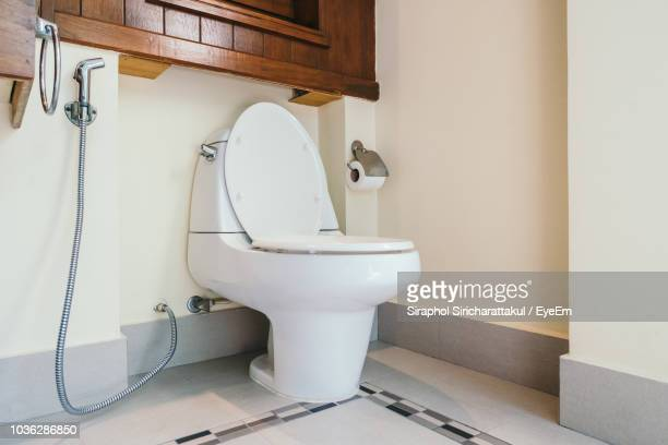 toilet seat in bathroom - toilet bowl stock photos and pictures