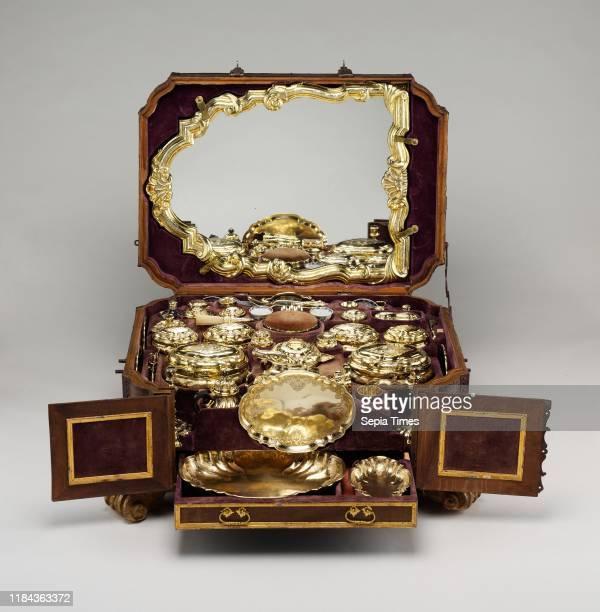 Toilet set in original leather case circa 174345 German Augsburg Gilt silver hardpaste porcelain cut glass walnut carved and partially gilt...