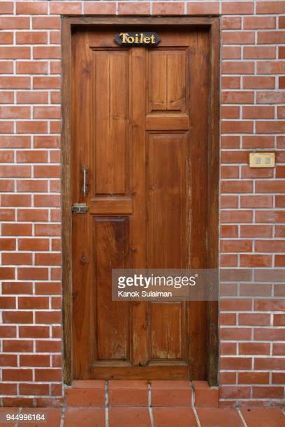Toilet sign on wooden door