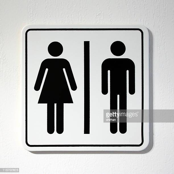 toilet sign - social inequality stock pictures, royalty-free photos & images