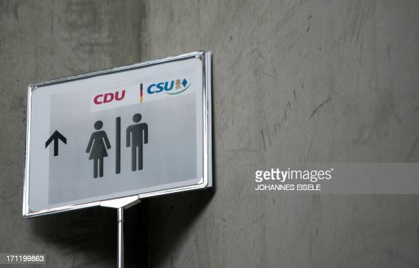 A toilet sign with the logo of the Christian Democratic Union and the Christian Social Union is pictured at a party meeting on June 23 2013 in Berlin...