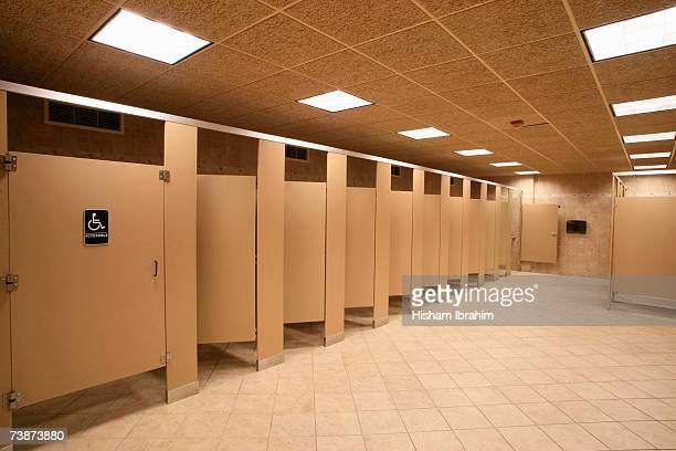 Toilet stalls in a public restroom, Delaware, USA