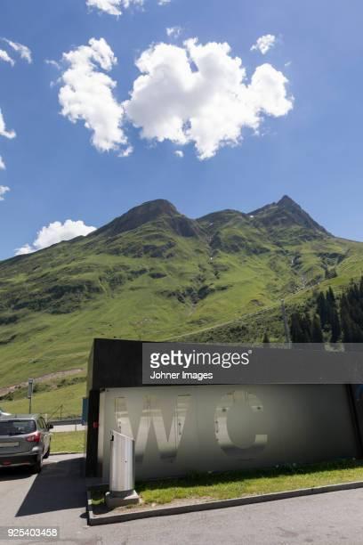 Toilets in mountain landscape
