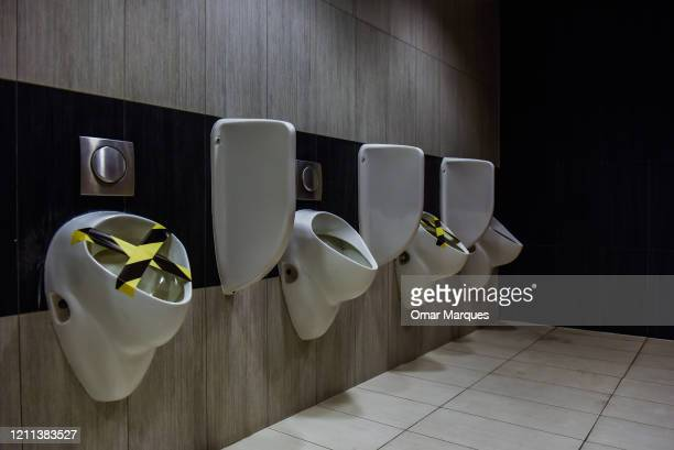 Toilets with colourful tape are pictured as social distance measures are taken before the reopening of the Bonarka shopping mall on April 30 2020 in...