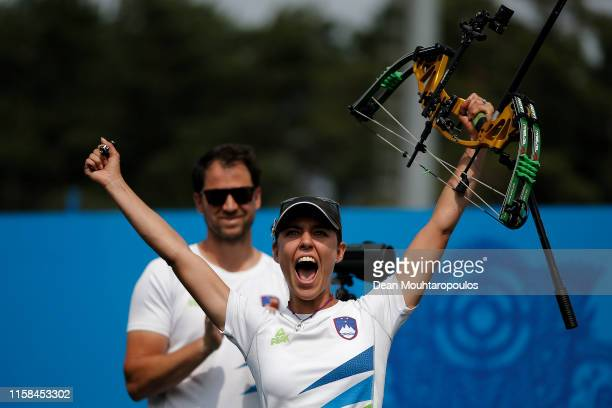 Toja Ellison of Slovenia celebrates victory after she competes against Natalia Avdeeva of Russia in the Women's Compound Individual Archery Gold...
