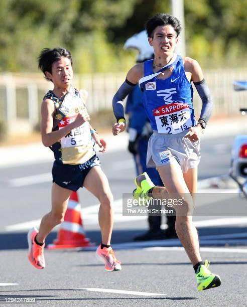 Tokai University 3rd runner Shotaro Ishihara leads to Tokyo International University 3rd runner Hikaru Uchida on day one of the 97th Hakone Ekiden on...