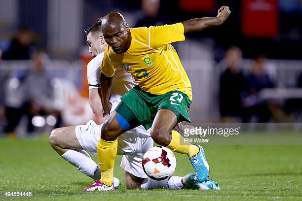 Tokelo Rantie of South Africa evades the tackled of Tim Payne of New Zealand during the International Friendly match between the New Zealand All...