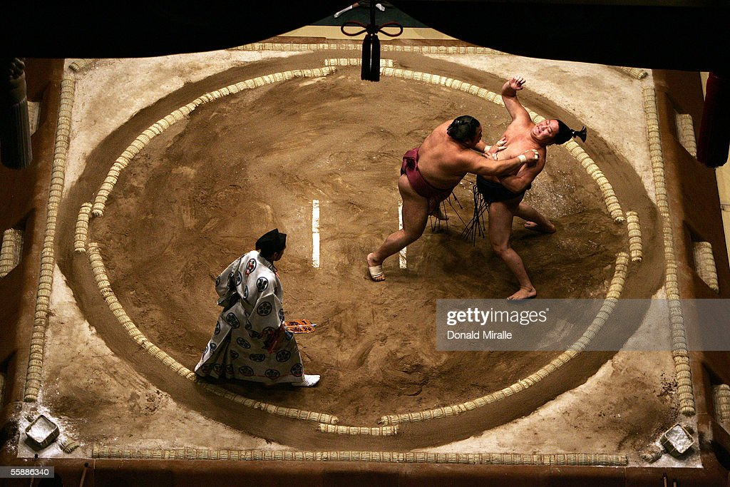 Tokitenku of Mongolia (L) and Chiyotaikai of Japan slap each other as they wrestle under the Dohyo as the Gyoji officiates during the Grand Sumo Championship on October 9, 2005 at Mandalay Bay Events Center in Las Vegas, Nevada.