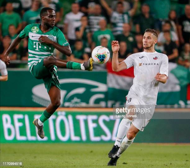 Tokmac Chol Nguen of Ferencvarosi TC fights for the ball with Jovan Cadjenovic of FK Suduva during the UEFA Europa League Play-off Second Leg match...