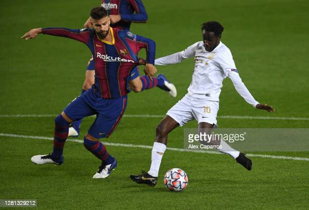 Tokmac Nguen of Ferencvaros Budapest is fouled by Gerard Pique of FC Barcelona leading to a penalty during the UEFA Champions League Group G stage...
