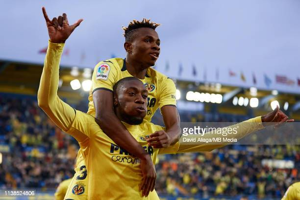 Toko Ekambi of Villarreal CF celebrates his sides second goal with his teammate Samuel Chimerenka Chukweze during the La Liga match between...