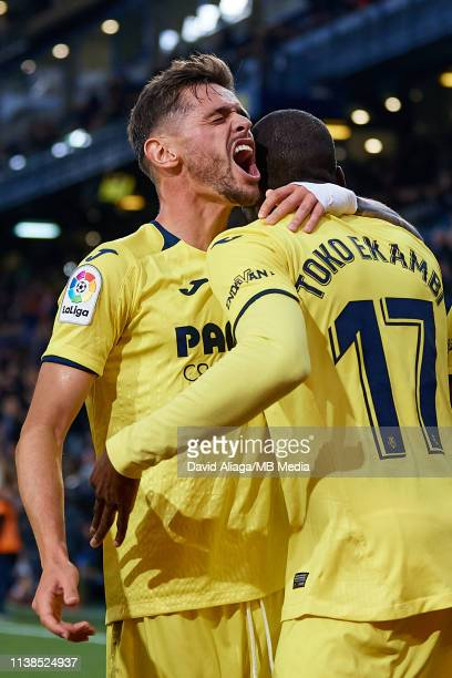Toko Ekambi of Villarreal CF celebrates his sides second goal with his teammate Xavi Quintilla during the La Liga match between Villarreal CF and CD...