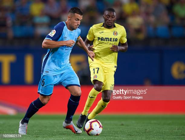 Toko Ekambi of Villarreal competes for the ball with Alex Granell of Girona during the La Liga match between Villarreal CF and Girona FC at Estadio...