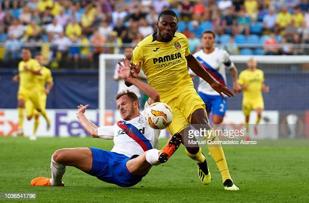 Toko Ekambi of Villarreal is tackled by Andrew Halliday of Rangers during the UEFA Europa League Group G match between Villarreal CF and Rangers at...